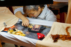 Workers embroider with silk Stock Photo