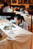 Workers embroider with silk Stock Photos