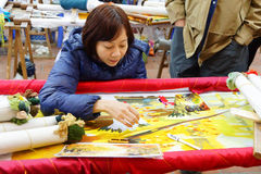Workers embroider with silk Royalty Free Stock Photography