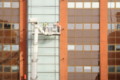 Workers is engaged in restoration of the modern multi-storey building in Helsinki Royalty Free Stock Photos