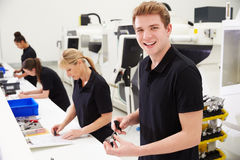 Workers In Engineering Factory Checking Component Quality Royalty Free Stock Photo