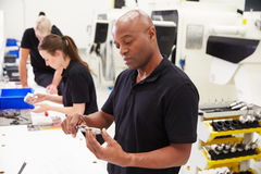 Workers In Engineering Factory Checking Component Quality Stock Photography