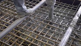 Workers and engineers pour foundation. Tons of concrete and reinforcement form a solid monolithic compound. Big project in construction stock video