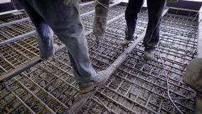 Workers and engineers pour foundation. Tons of concrete and reinforcement form a solid monolithic compound. Big project in construction stock footage