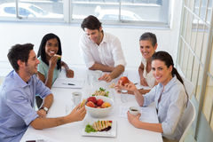 Workers enjoying sandwiches for lunch Stock Image