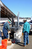 Workers with evaporator for maple syrup Royalty Free Stock Photos