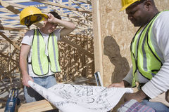 Workers Examining Plan At Site Stock Images