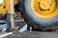 Workers excavate the pit with an excavator. Road repair. Pipeline failure royalty free stock photos