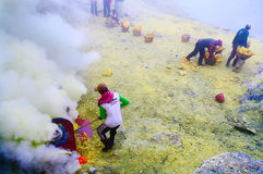 Workers extracting sulfur inside crater in Ijen Stock Image