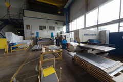 Workers in extrusion workshop at plant Stock Images
