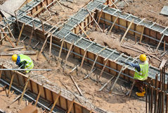 Workers fabricating ground beam reinforcement bar Royalty Free Stock Photo