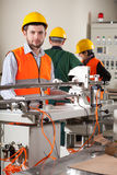 Workers in factory Royalty Free Stock Photos