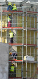 Workers on falsework Stock Image