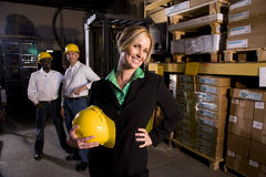 Workers with female boss in storage warehouse Stock Photos