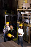 Workers with female boss in storage warehouse stock image