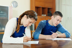 Workers filling in questionnaire Royalty Free Stock Photo
