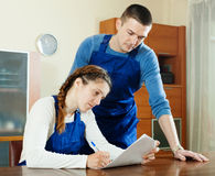 Workers  filling in questionnaire at table Stock Image