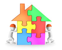 Workers finishing the colored house puzzle. 3d rendered illustration Royalty Free Stock Image