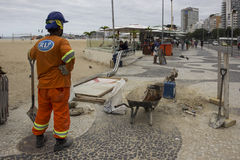 Workers are finishing in Copacabana for the Olympics. Rio de Janeiro, Brazil, 13 June 2016: Laborers working to make repairs on the boardwalk of Copacabana Beach Stock Photography
