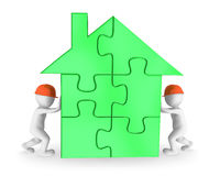 Workers finishing the green house puzzle. 3d rendered illustration Royalty Free Stock Photo