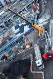 Workers fitting high heavy crane using mobile truck lift in Lond Stock Image