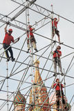 Workers fix holiday decoration on the Red Square in Moscow.