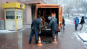 Workers fixing the cable near TSUM Central Department Store, Kiev, stock video footage