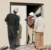 Workers Fixing Door Royalty Free Stock Images