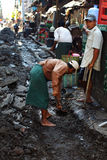 Workers fixing the road after the downpour in Myanmar Royalty Free Stock Photo