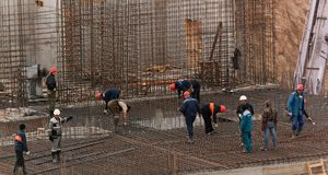 Workers with forwork frames. Construction workers busy with forwork frames Royalty Free Stock Photo