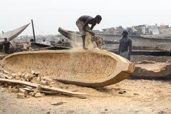 Workers in ghana. Accra, Ghana - December 28, 2016: men build wooden boats in Accra, Ghana Stock Photos