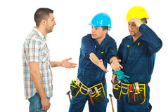 Workers giving explanations to a client. Constructor workers team giving explanations to client  isolated on white background Stock Photo