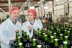 Workers at glass bottle factory Stock Photo
