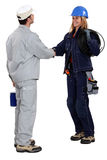 Workers greeting each other Stock Images