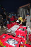 Workers are grinding ice to preserve tuna fish in the Hon Ro seaport, Nha Trang city Stock Photography