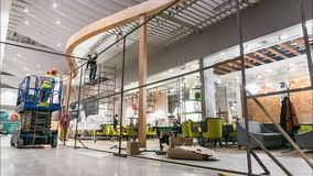 Workers group assemble cafe facade in center hall timelapse