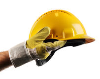 Workers hand holding hard hat. Male workers hand holding modern yellow hard hat Stock Photos
