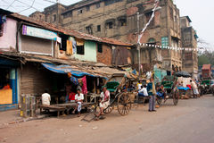 Workers of hand-pulled rickshaw have rest on the street Stock Photo