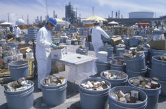 Workers handling toxic household wastes stock photos