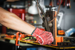 Workers hands using with bending machine rebar for building equi. Pment . selective focus Stock Photo