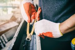 Workers hands using pincers bind steel wire to rebar before concrete is poured over it. Close up of workers hands using pincers bind steel wire to rebar before stock photography