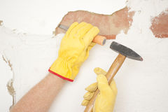 Interior House wall renovation hammer and chisel Royalty Free Stock Images