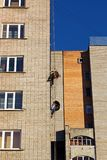 Workers hang the advertising on a building stock photography