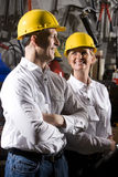Workers with hard hats in maintenance room royalty free stock photos