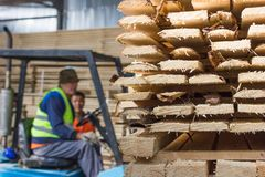 Workers have deal with planks Stock Photo