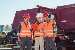Workers in a heavy transport freight forwarding company. Looking at vehicles stock images