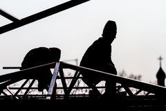 Workers high-builders build a roof Royalty Free Stock Images
