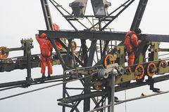 Workers on High Crane Stock Photography
