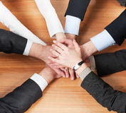 Workers hold hands together Stock Photo