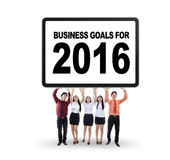 Workers hold a placard with business goals for 2016 Stock Photography